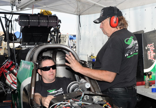 Car owner Kenny Gilmour and driver Greg Hunter warm up their TAD prior to eliminations.