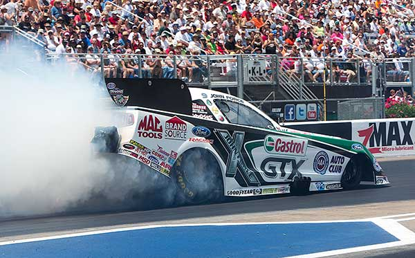 John Force was a popular winner in Funny Car driving his Mustang to victory during the Ford Dealers presented event.