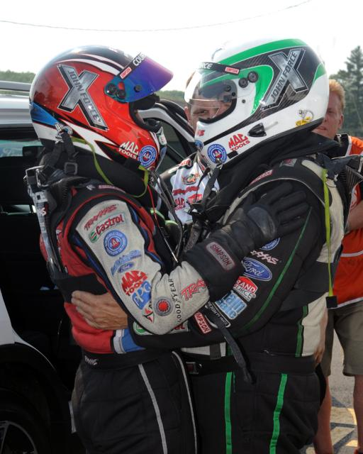 Courtney and John Force paired off for an historical fuel FC final round at New England Dragway.