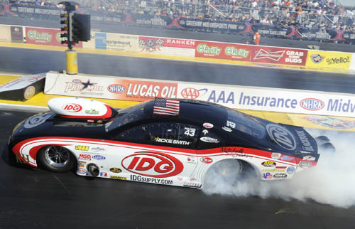 Wily veteran racer Rickie Smith has clinched the 2013 NHRA Pro Mod Series points championship