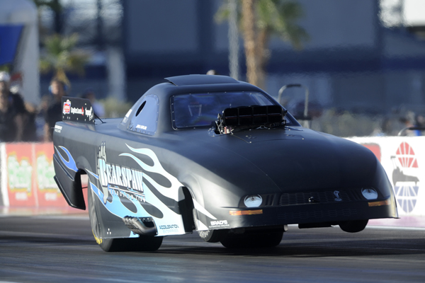 Jirka Kaplan's Calgary-based Mustang hiked it's wheels nicely during this 5.634 secs qualifying run.