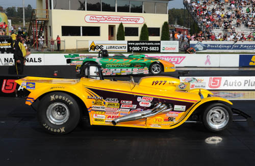 Charlie Kenopic (near lane) won NHRA's national event in Super Gas last weekend