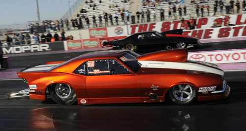 This first round pairing in Pro Mod was all Canadian Camaros with Mike Gondziola (near lane) defeating Brent Williamson.