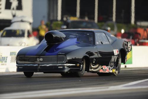Jim Laurita's nitrous-injected Camaro set low ETat 5.847 secs to qualify #1 before losing in a round one upset.