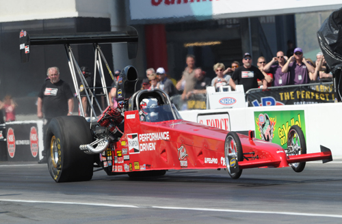 Corey Michalek, competing in his very first NHRA national event race - won in Top Alcohol Dragster!