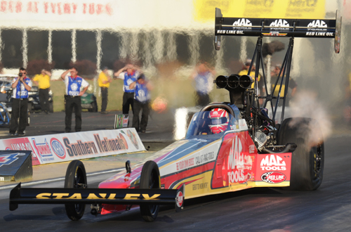 Doug Kalitta set both low ET and top speed while increasing his NHRA points lead with a runner-up event finish