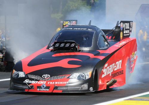Cruz Pedregon roared to the quickest ET in NHRA fuel FC history (3.959 secs) while winning in his Toyota