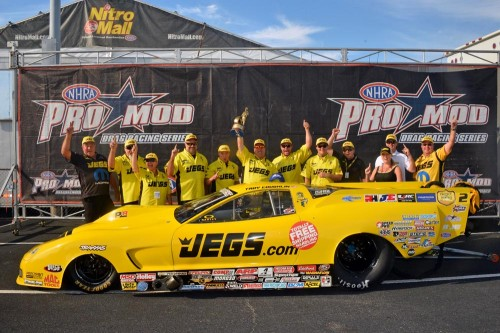 Troy Coughlin made up ground in NHRA Pro Mod points by winning the rain-delayed Concord event final.