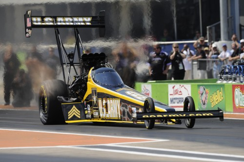 Tony Schumacher scored back to back wins on consecutive days to vault into 1st place in NHRA Mello Yello Championship points