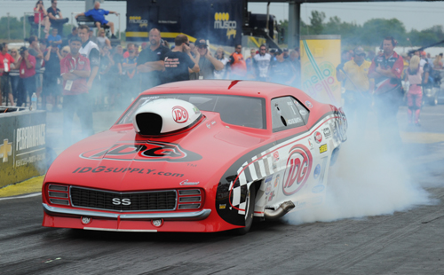 Wily veteran Rickie Smith scored over a record sized NHRA Pro Mod field