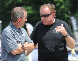 Jim Bell (right) discusses strategy with Tim McAmis