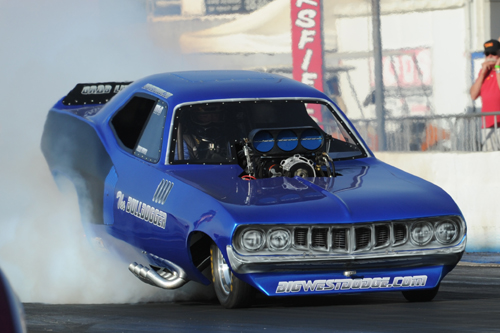 """Jim Bersch thinned the capacity crowd with another series of awesome burnouts in his """"Bull Dogger"""" Barracuda."""
