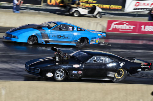 Derek Hawker (near lane) advance in round #3 of PM  while Michael Biehle crashed his Mustang