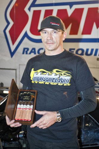 Toronto's Jerry Mitrovic stood tall post race - and he had the brass knuckles to commemorate his huge Outlaw 10.5 win.