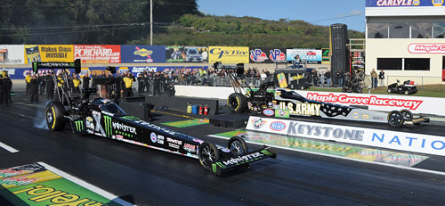 Top Fuel low qualifier - Brittany Force - smoke the tires in the semi final round versus Tony Schumacher