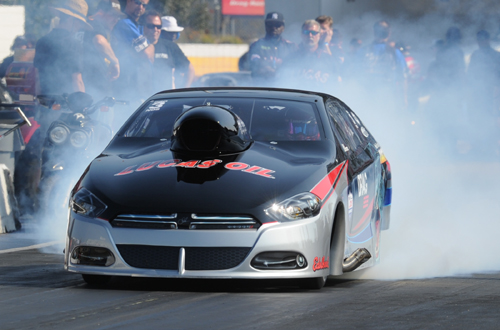 Driving her '15 Dart, lady racer Lizzy Musi upset the Pro Nitrous class at VMP.