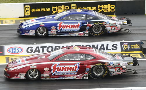 Greg Anderson (near lane) defeated Jason Line in the Pro Stock final round