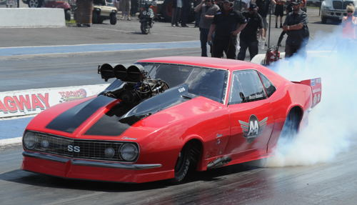 Wily Canadian drag racer Bruce Boland has drawn first season blood for the USDRS