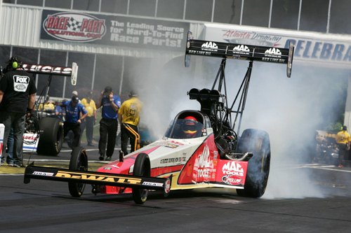 Doug Kalitta notched his 40th career NHRA top fuel title.