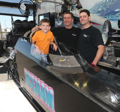 """Three Perry Generations -- We just like this photo. Ken Perry and his son Adam had their Markham-based """"Iceman"""" TAD at Cayuga last week for some testing. That's Adam's son Charlie in the cockpit. Maybe following family footsteps?"""