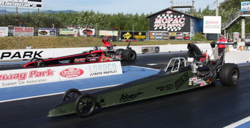 Using some terrific driving - Alberta's Frankie Giroux (near lane) won the Top Dragster title