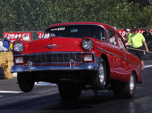 Rick Pike had his old school '56 Chevy in fine wheel standing form!