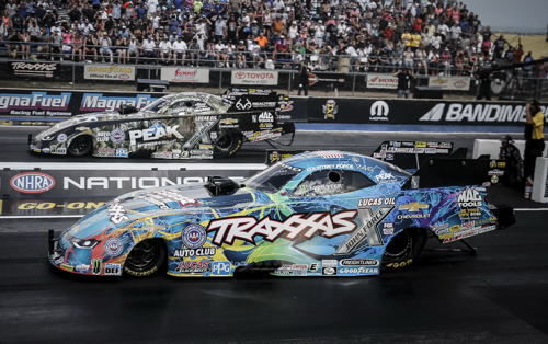 Denver's fuel FC final featured two Chevy Camaro cars with John Force (far lane) defeating his daughter Courtney.