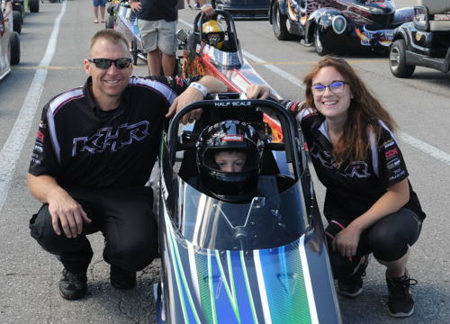 That's Kyle Harris with his son Ryan (in car) and daughter Christina. KHR had three race cars on hand for the weekend!