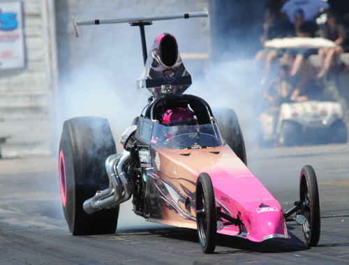 """Shawna Woodstra scored in the """"Top"""" consolation event driving her dragster."""