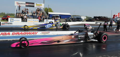 Racing her dragster Shawna Woodstra (near lane) has already added some strong event placings to her racing resume this season.