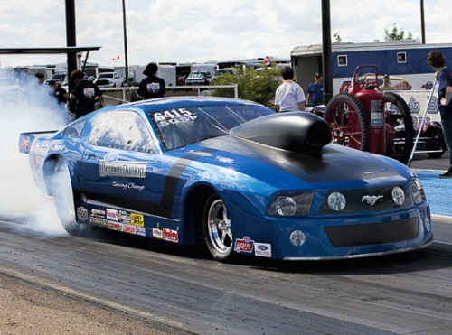 Bill Cawsey (from Regina Saskatchewan) was a winner during the NHRA Lucas Oil Division 5 race held at Topeka KS (July 31st). Racing his 2009 model Ford Mustang - Bill won an all Canada Super Gas final round at the event topping the '12 Corvette raced by Manitoba's Kevin Dyck in the final round. That was a super close decision too with both drivers running identical breakout 9.889 secs elapsed times (with Cawsey's slightly superior .006 RT making the difference) (DragRaceCanada File Photo by: Don Meleshko)