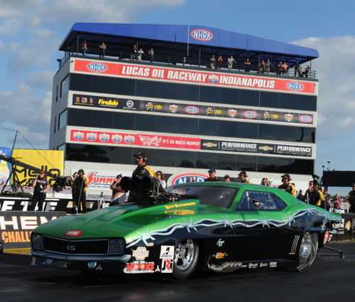With the iconic tower in the background - Whitby's Eric Latino leaves the starting line during Pro Mod qualifying. He ran a superb 5.859 secs to qualify #8