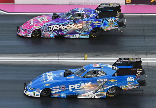 John Force (near lane) was first to the finish line stripe racing his daughter Courtney in the FC final round.